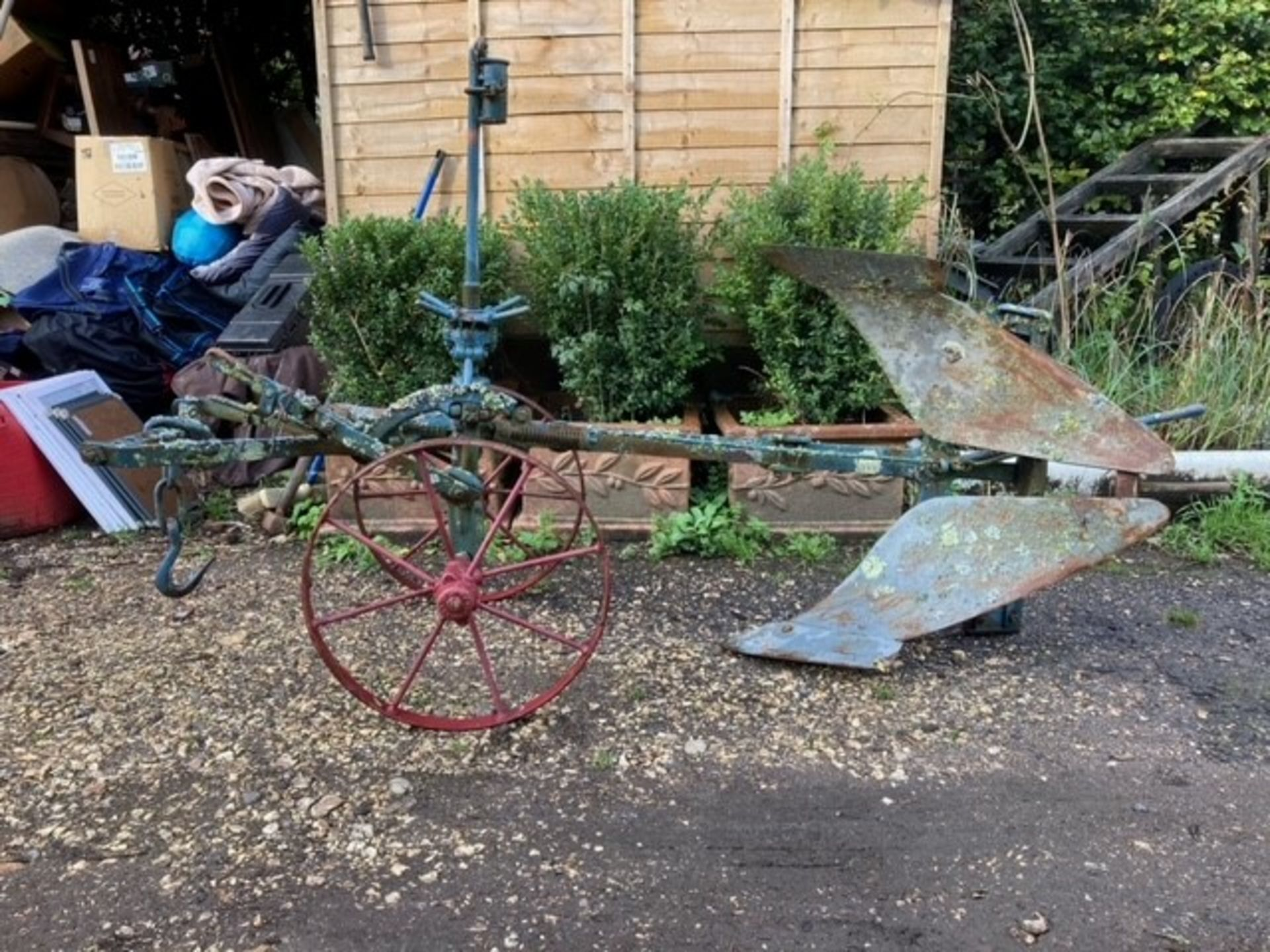 HORSE-DRAWN REVERSIBLEPLOUGH made by Brevet, and painted blue. Lot 14 is located at the Reading