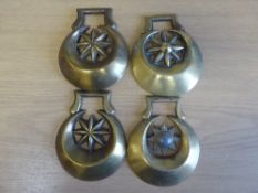 4 x stamped crescent-shaped brasses each with eight-sided centre star and 1 other crescent cast bras