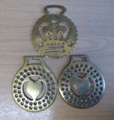 3 brasses - 2 cast brasses with heart centres surrounded by perforations and getts on reverse, and a