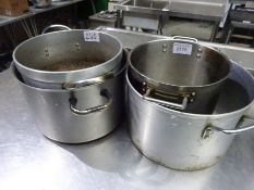 4 large cooking pots.