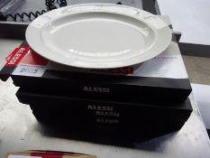 4 Alessi serving plates.