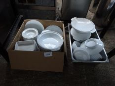 Two boxes of white china.