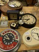 Eight various clocks and a Kodak Brownie Holiday Flash camera.