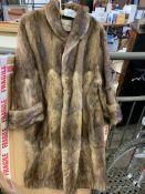 Long pale brown fur coat by Marcus.