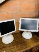 Two Apple iMacs.