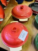 Two red Le Creuset casserole dishes.