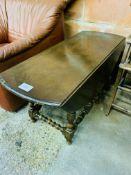 Ercol style low drop side gate leg table.