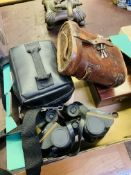 Pair of WW1 binoculars; a pair of WW2 binoculars; and other items.