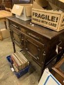 Concert Grande oak gramophone cabinet with a quantity of 78 rpm records.