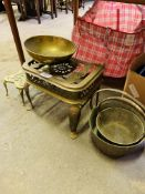 Two brass trivets and brass preserving pans.
