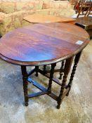 Two oak drop-side tables.