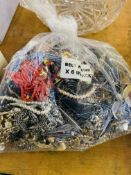 Bag containing a large quantity of costume jewellery. Estimate £20-40.