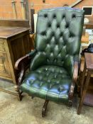 Green buttoned leather upholstered swivel chair.