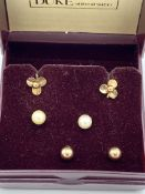 3 pairs of 9ct gold earrings.
