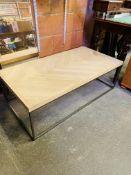 Hardwood coffee table on metal legs.