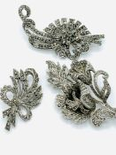 Three marcasite brooches.