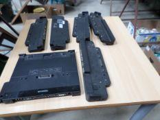 Laptop docking stations, 6 Fujitsu, 1 Toshiba