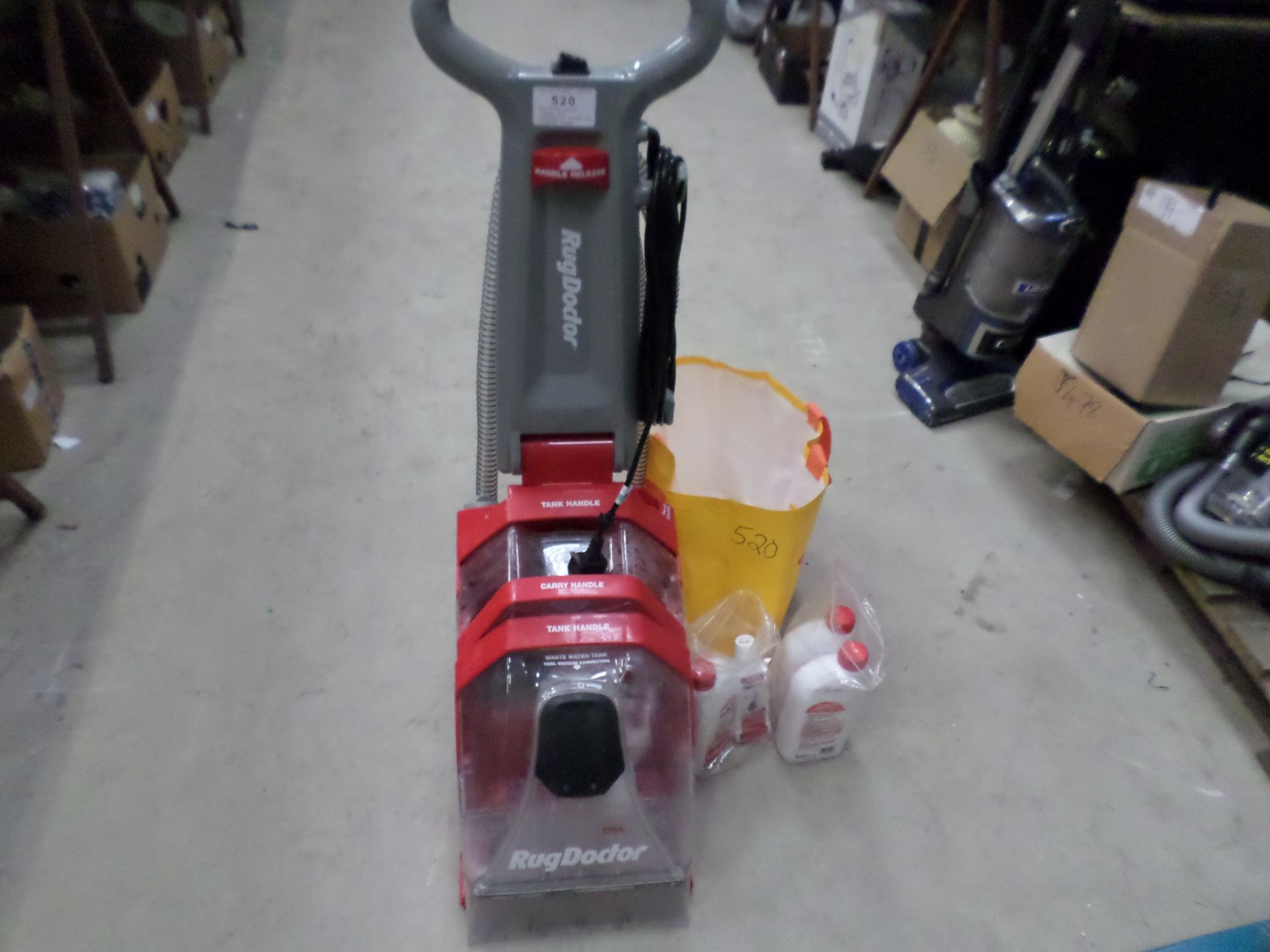 Rug Doctor carpet cleaner with attachments, manual and cleaning fluids