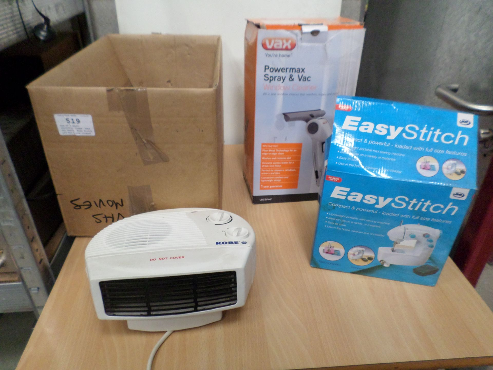 Lot 519 - Box of 3 small electrical items, Kobe fan heater, Easy Stitch and Vax window cleaner