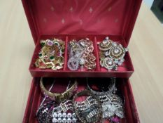 Red box of jewellery