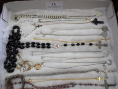 Tray of religious type costume jewellery