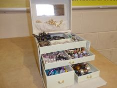 Cream box of jewellery