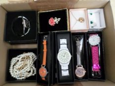 An assortment of 5 ladies watches and boxed jewellery