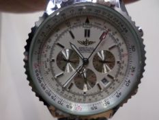 Stainless steel watch with Breitling marked on face, back and strap