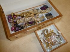 Beige box of jewellery