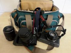 Canon Pentax cameras in carrying case with extra lenses, good condition