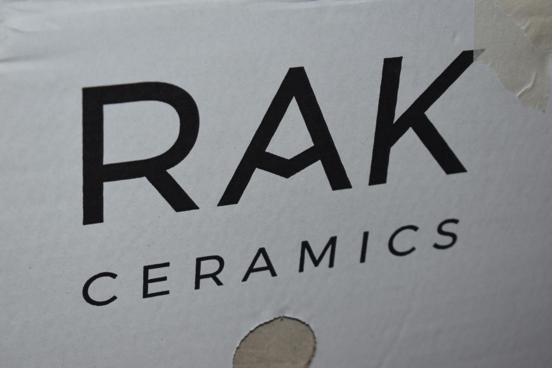 Lot 2558 - 12 x Boxes of RAK Porcelain Floor or Wall Tiles - Concrete Rustic White Design - 30 x 60 cm Tiles