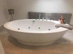 Luxurious Bathroom Suite including Jetted Bath, Shower Unit, Sink Unit with Mirror, Toilet and
