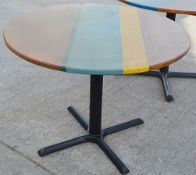 1 x Commercial 100cm Round Tables Featuring Abstract Paint Work And Metal Base