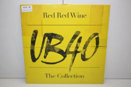 GRADE U- ***VINYL RECORD*** RED RED WINE UB40 THE COLLECTION