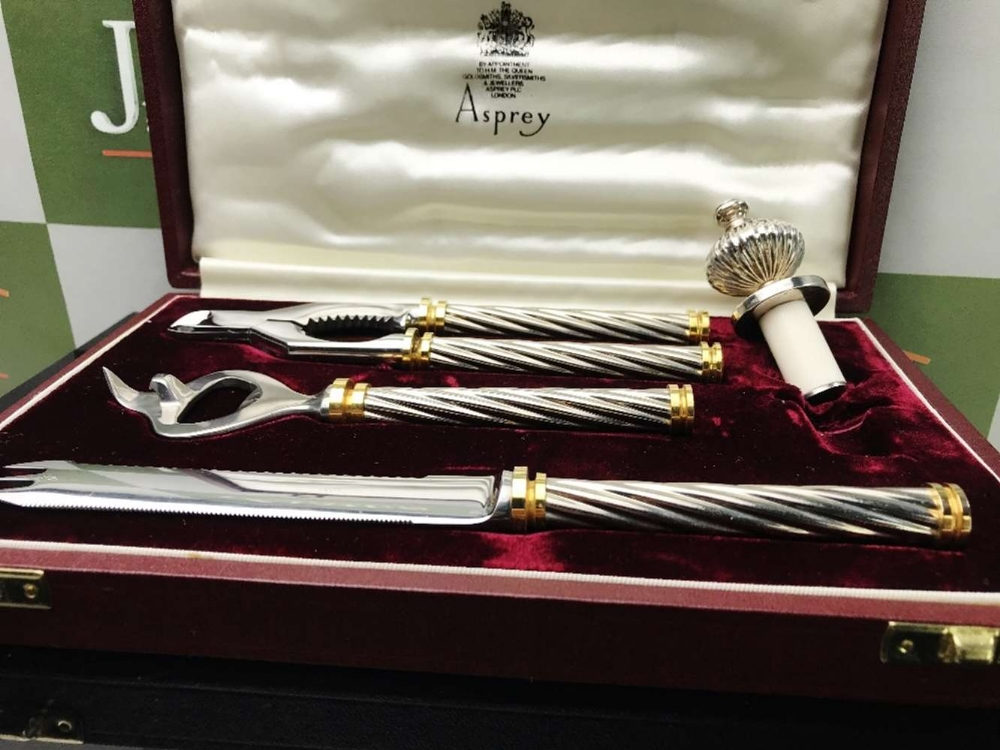 Lot 21 - Asprey Silver 4 Piece Set: Bottle Opener, Nut Cracker, Knife and Bottle Stopper