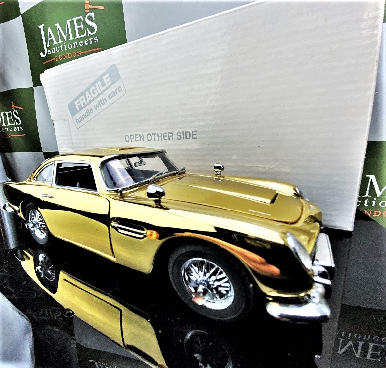 Lot 26 - Danbury Mint James Bond 22 Carat Gold Plated-Aston Martin DB5 1-24 Scale