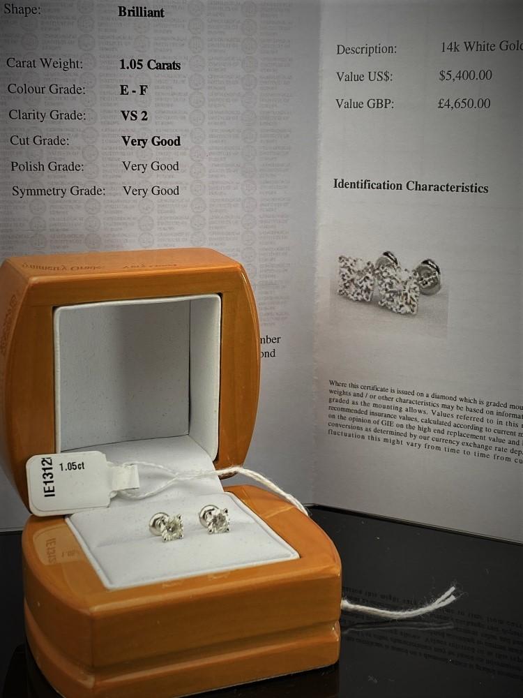 Lot 7 - Pair of New 1.05 Carat Round Cut VS2/E Diamond Stud Earrings 14K White Gold