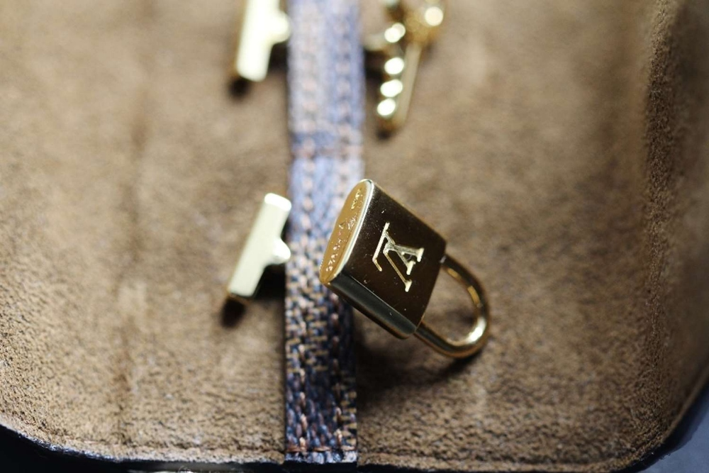 Lot 23 - Louis Vuitton Cufflinks 925 Silver Gold Plated with Brown Damier Pouch.