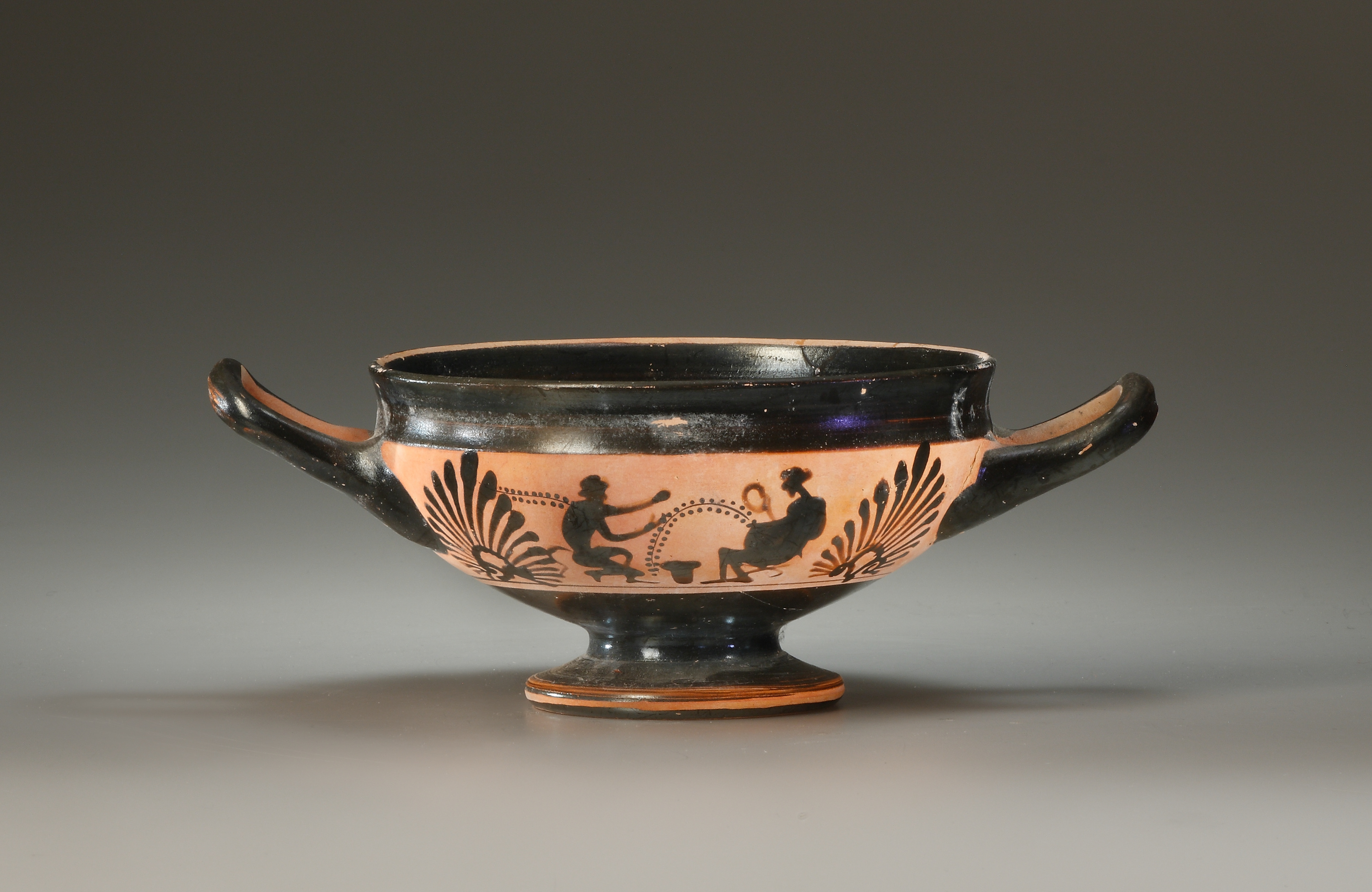 Lot 16 - A Boeotian Black-Figure Cup with Dionysian Figures
