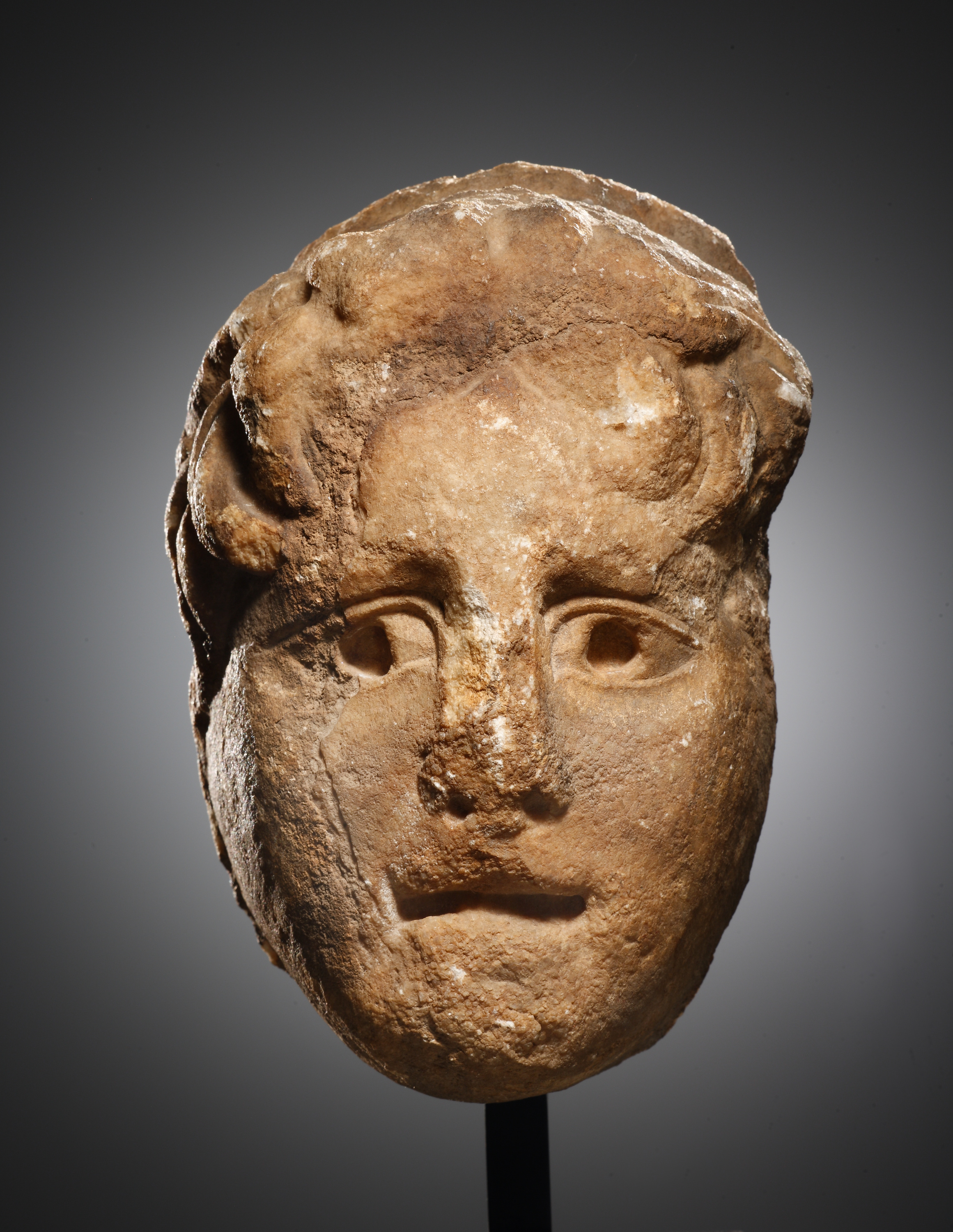 Lot 49 - A Head of a Youth in Relief