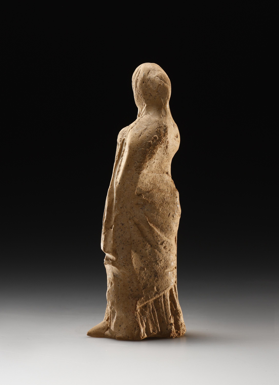Lot 24 - A Small Statuette of a Draped Female