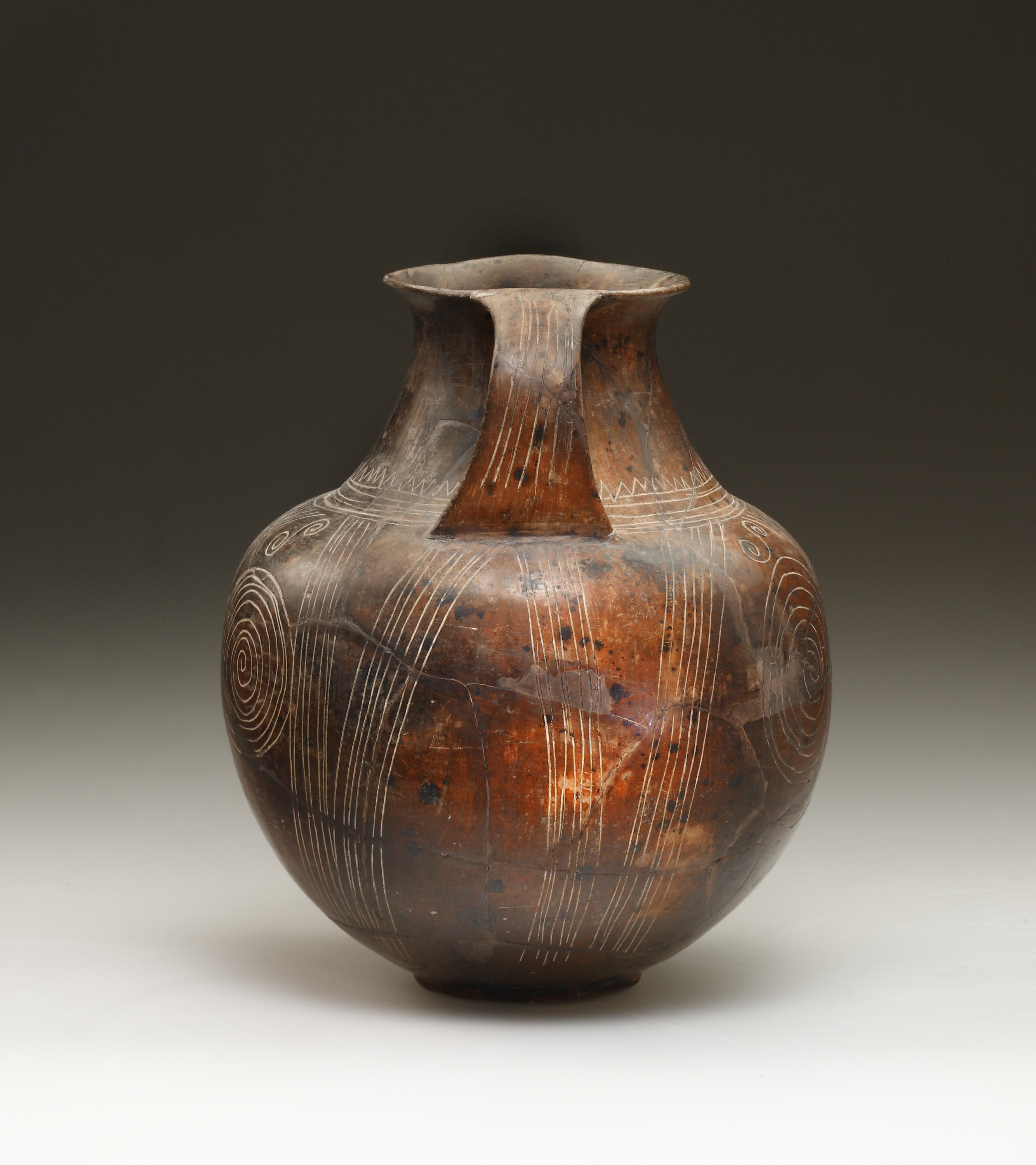Lot 9 - An Etruscan Impasto Amphora with Incised Geometric and Spiral Decoration