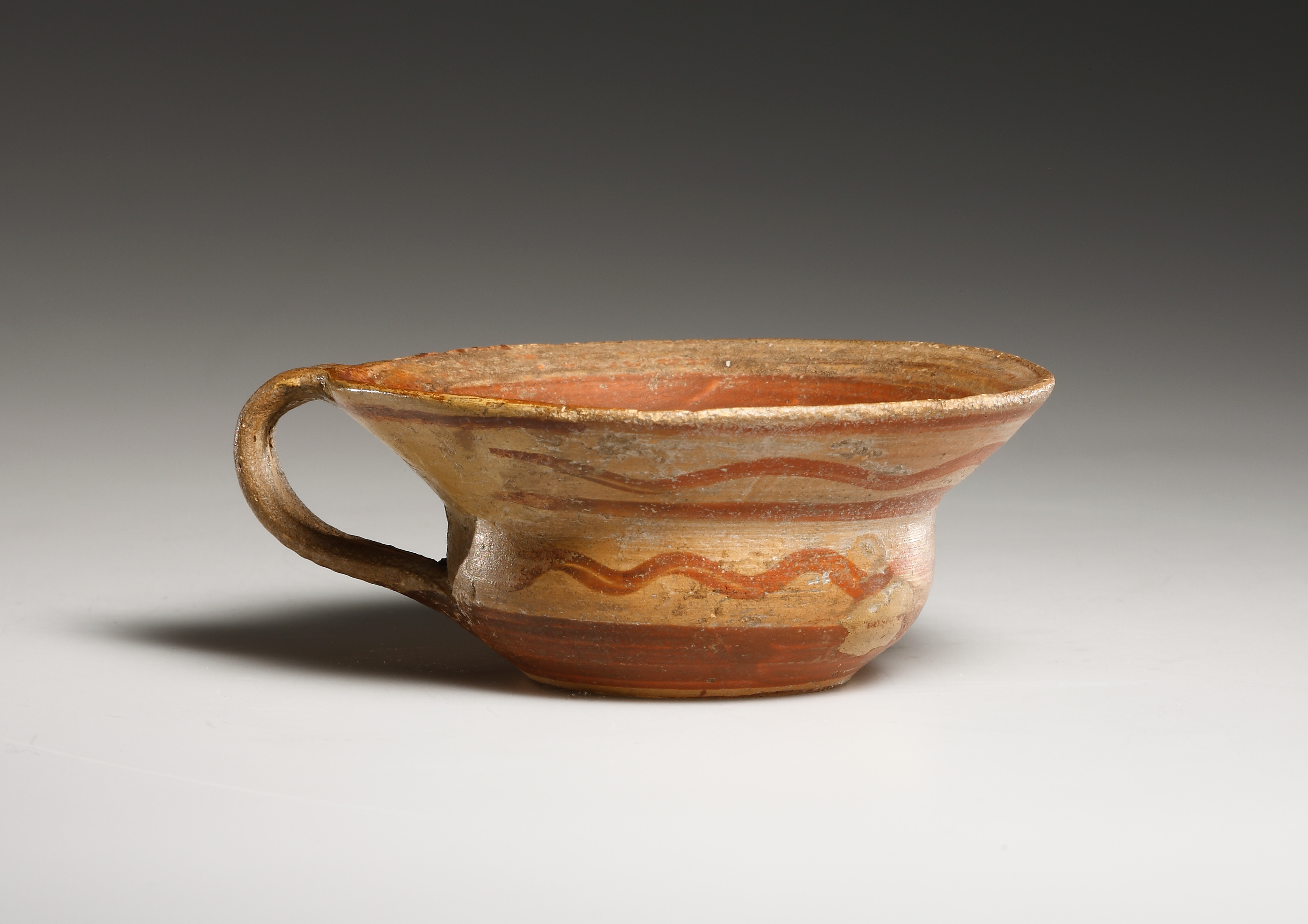 Lot 3 - An Early Mycenaean Cup decroated with Wavy Lines