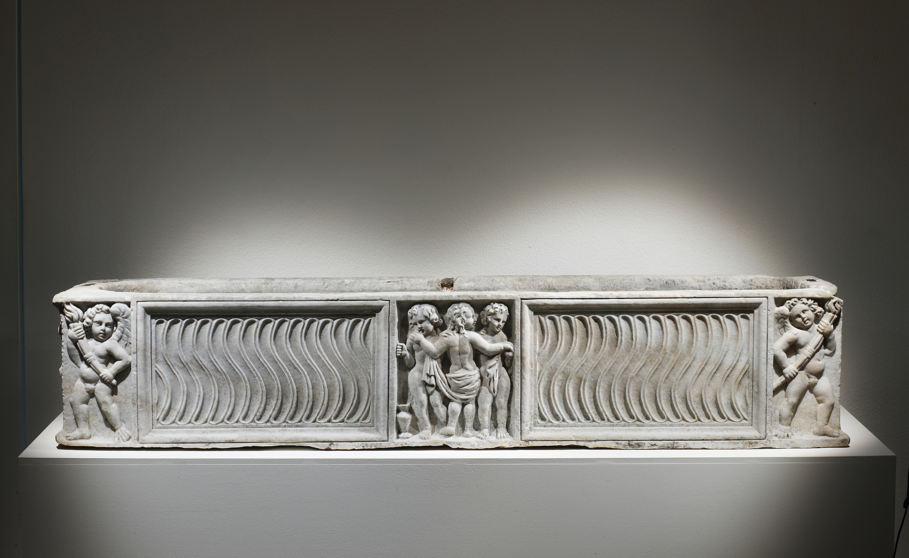 Lot 55 - A Strigilated Sarcophagus with The Three Graces