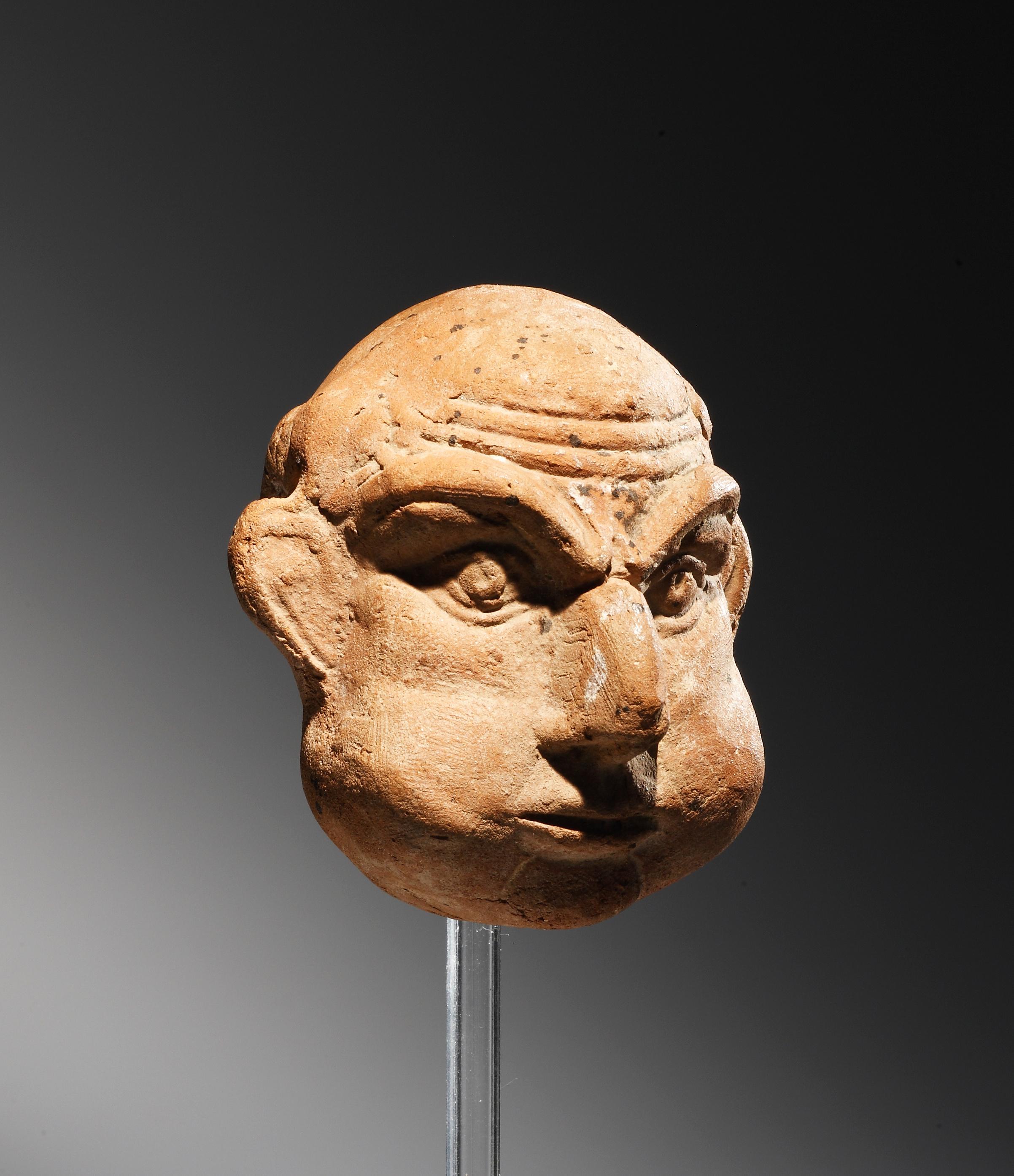 Lot 40 - A Grotesque Head of a Bald Man