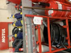 Motul rack and quantity of oil and plastic containers