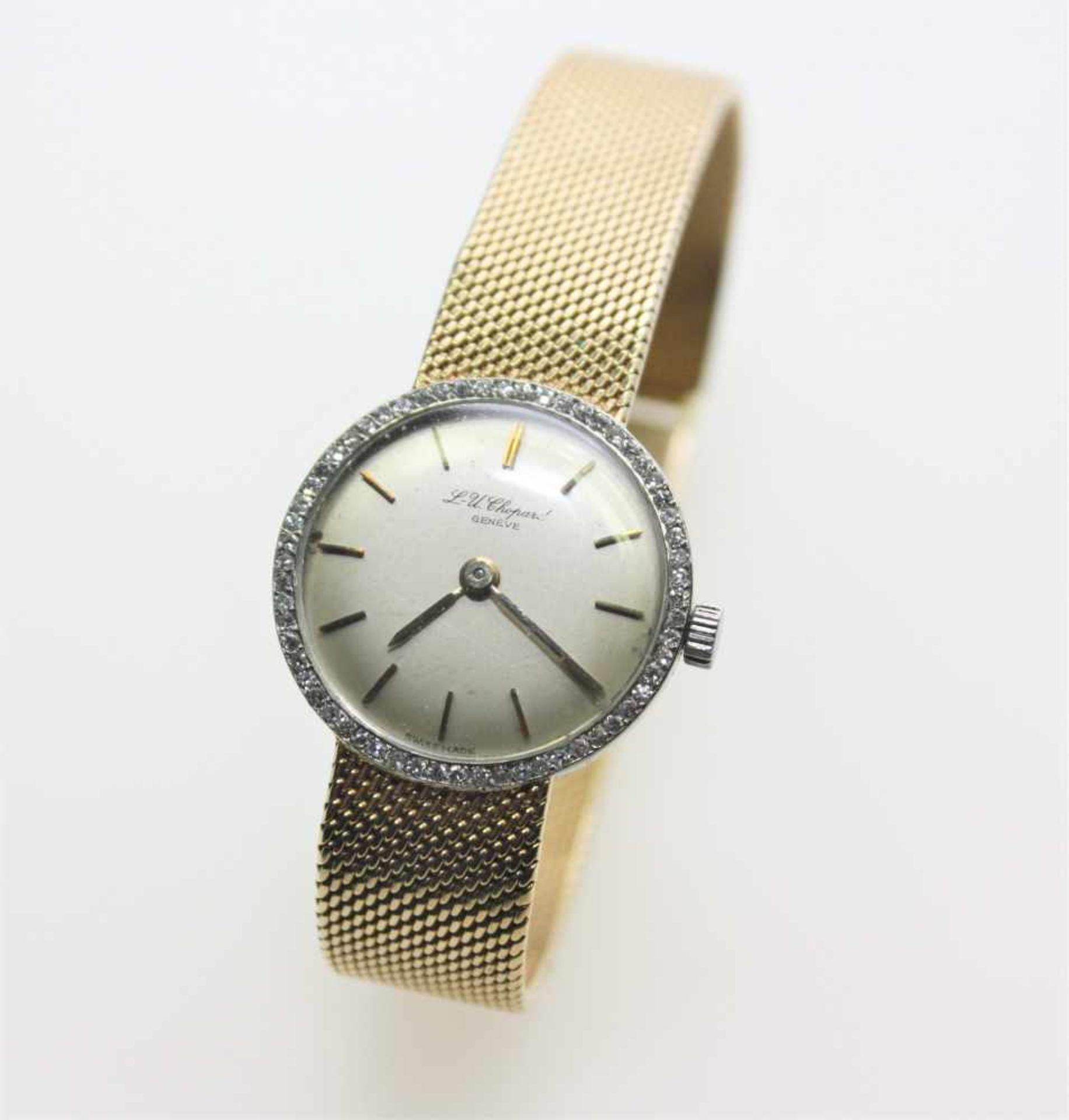 Los 25 - Ältere, goldene Damen-Armbanduhr mit fest angearbeitetem Ansatzband 750/f gest., rundes