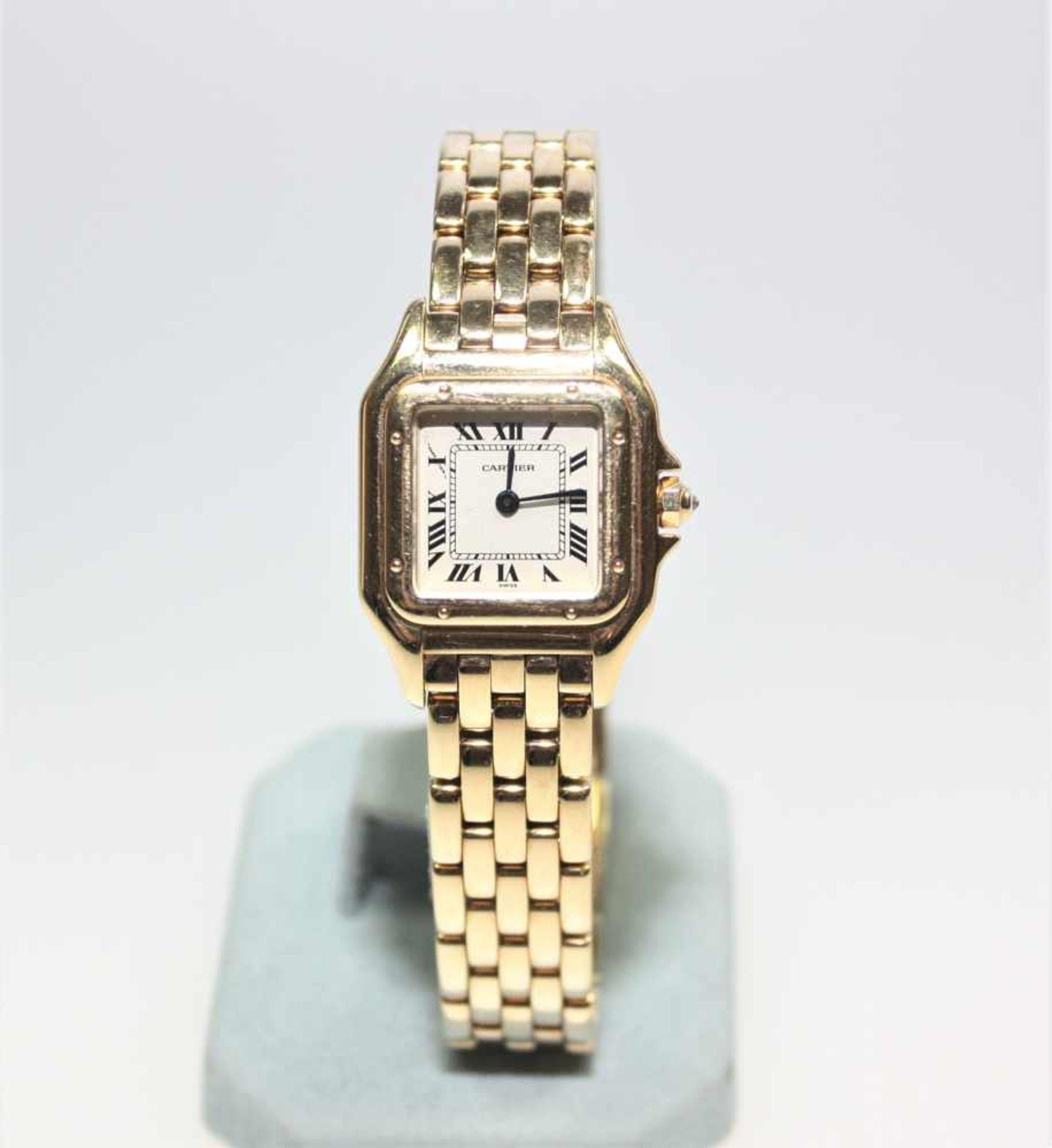 "Los 30 - Goldene Damen-Armbanduhr 750/f gest. signiert ""Cartier"", Lady Santos, Quarz, kleiner Diamant in"