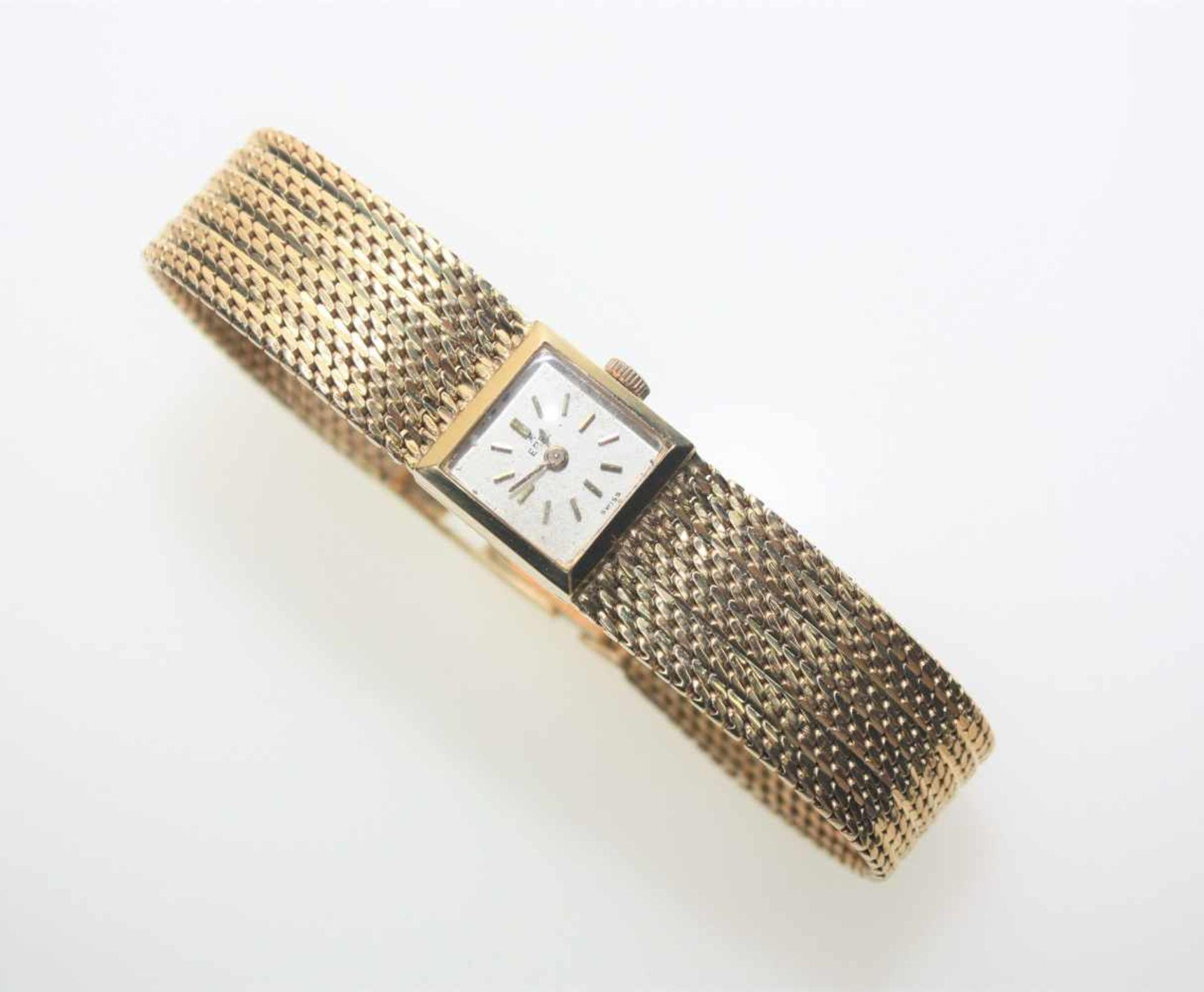 Goldene Damen-Armbanduhr mit fest angearbeitetem Ansatzband 750/f gest., quadratisches Zifferblatt
