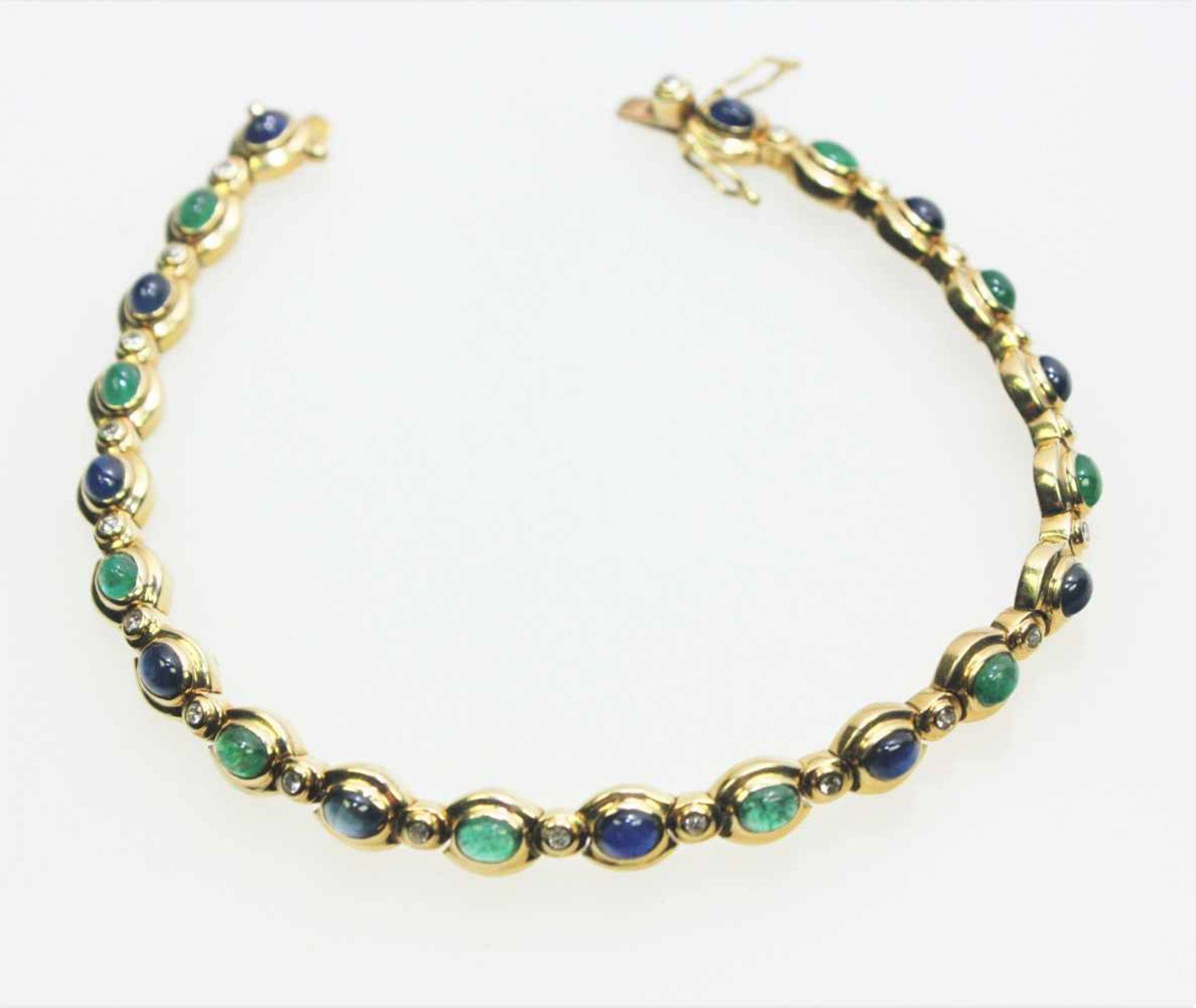 Los 14 - Zierliches, goldenes Gliederarmband 18 K gest., abwechselnd ausgefasst mit kleinen Saphir- und